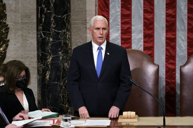 U.S. Vice President Mike Pence reads the final certification of Electoral College votes cast in November's...