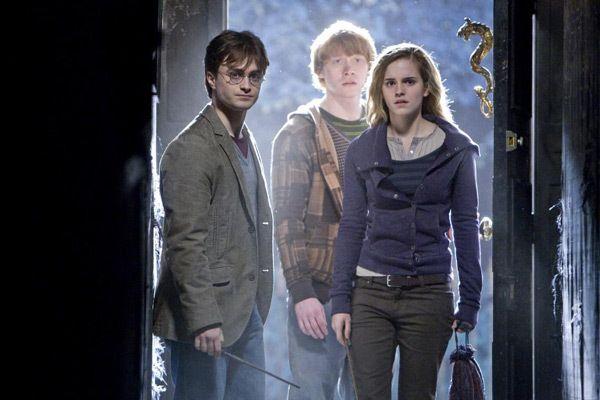 Harry, Ron et Hermione incarnés à l'écran par Daniel Radcliffe, Rupert Grint et Emma