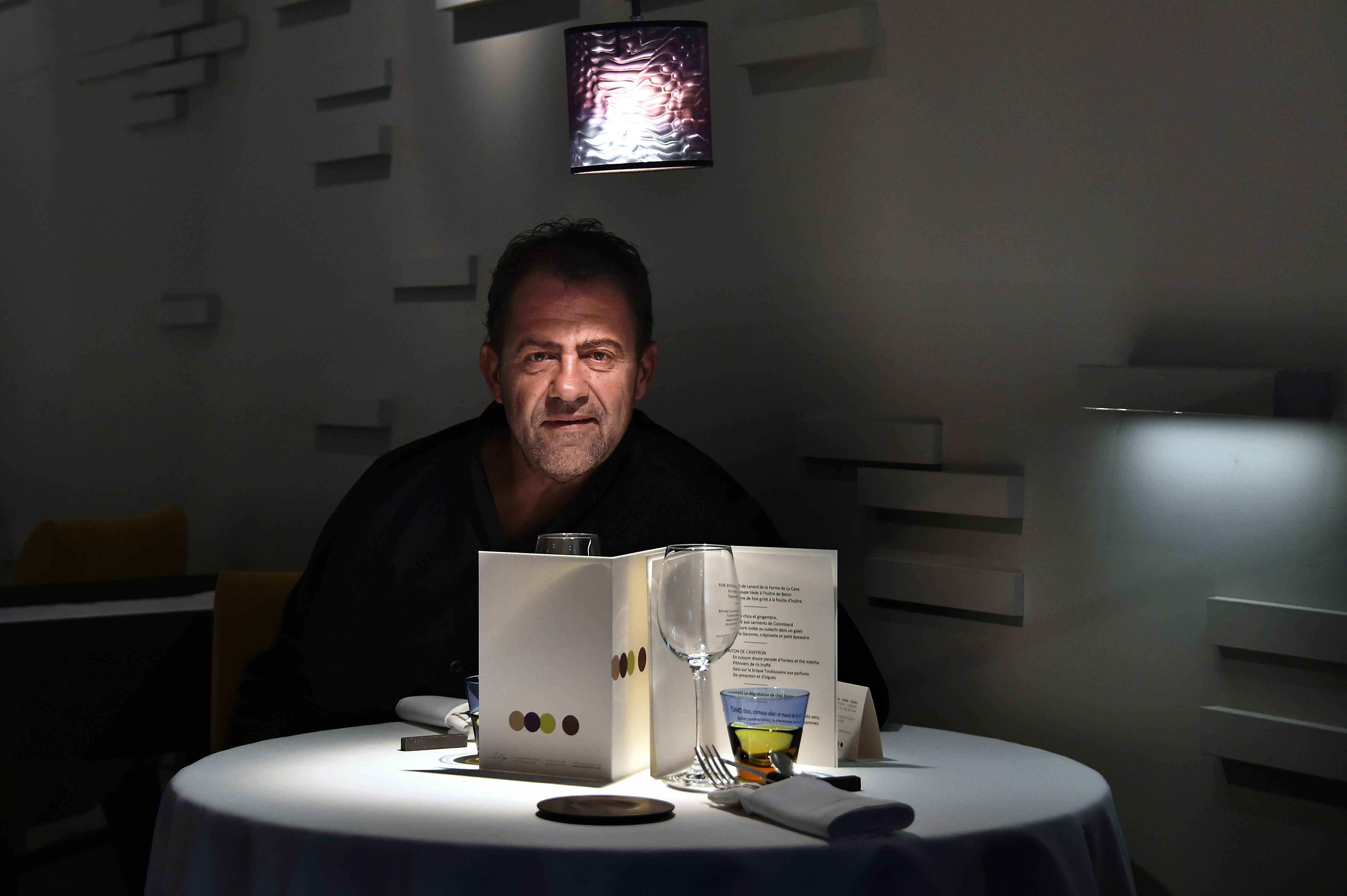 French chef Michel Sarran poses on July 11, 2016 in his restaurant in Toulouse, western France. / AFP...
