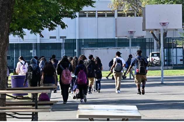 Students walk to their classrooms at a public middle school in Los Angeles, California, September 10,...